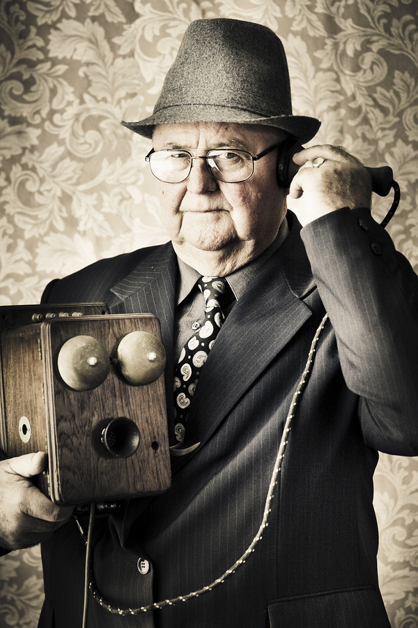 bigstock-Vintage-Business-Man-Using-Ret-33303704