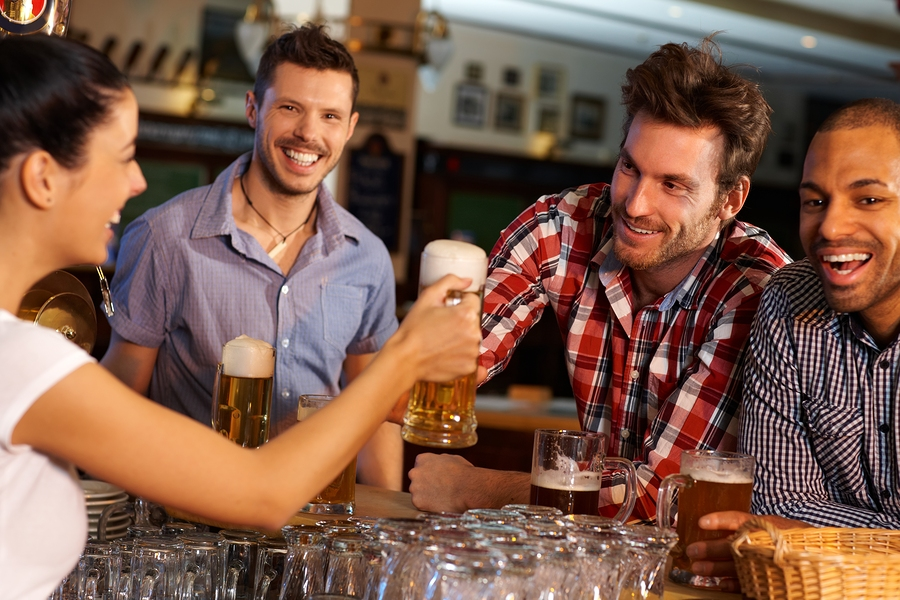 bigstock-Happy-friends-drinking-beer-at-45992998